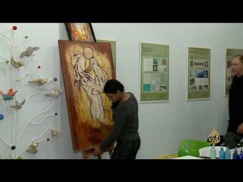 العرب اليوم - بالفيديو الرسم يجمع ثقافات العالم في مدينة الدوحة