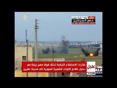 قصف قوات موالية للحكومة السورية أثناء دخولها عفرين