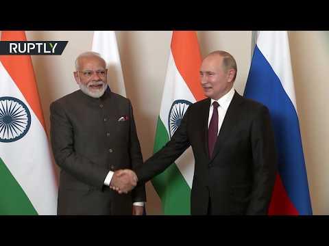 شاهد الرئيس فلاديمير بوتين يلتقي رئيس وزراء الهند في البرازيل