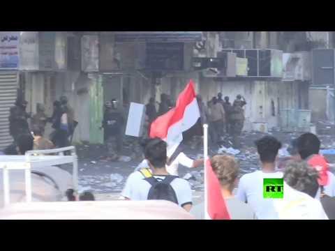 الشرطة تشتبك مع المحتجين في بغداد خلال التظاهرات الشعبية