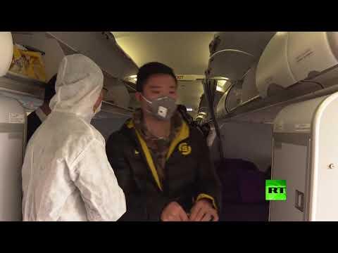 مطارات الصين تخضع المسافرين للفحص الحراري