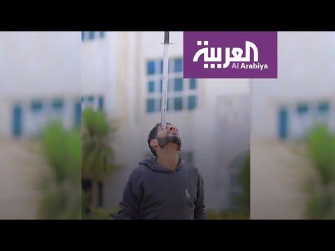 شاهد يمني عجيب يحمل أجسام ثقيلة جدا بذقنه