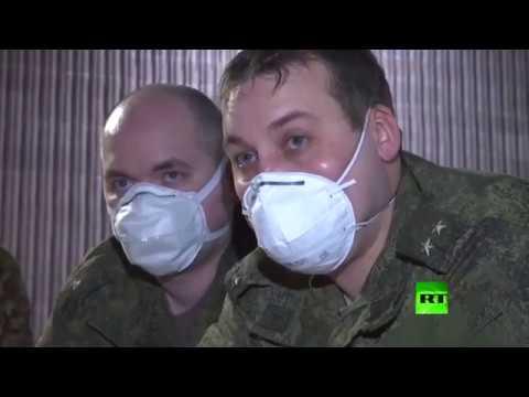 شاهد عسكريون روس يشاركون في تجهيز مستشفى ميداني في بيرغامو الإيطالية