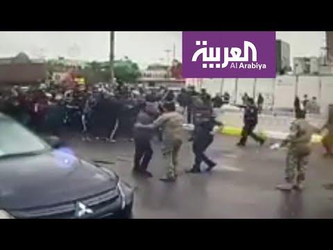 شاهد تدافع الأمن العراقي وزوار كسروا حظر التجول في الكاظمية