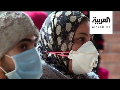 شاهد مشهد كوروني فريد في شوارع القاهرة لوجوه تكسوها الكمامات