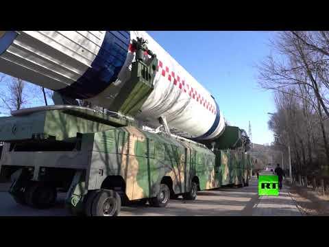 شاهد الصين تطلق 13 قمرًا صناعيًا بصاروخ واحد