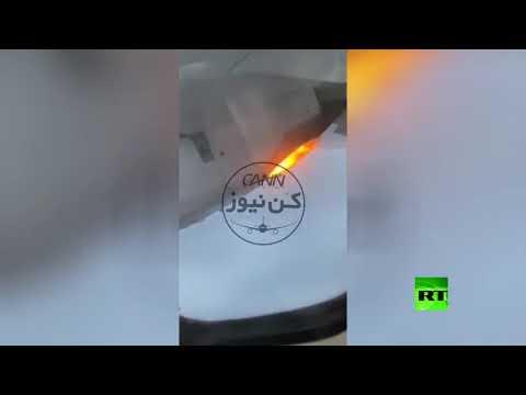 شاهد هبوط اضطراري لطائرة إيرانية في مطار مهر آباد بعد اندلاع حريق بها